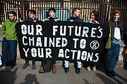 Members of the Extinction Rebellion Youth group locked themselves to the fence of Parliament demanding climate change action on May 3rd 2019 in London, United Kingdom. The youths carried a banner saying 'our future's chained to your actions' as a message for members of Parliament and they stayed for 3 hours. No arrests were made. The environmental protest group Extinction Rebellion has called for civil disobedience and peaceful protest to force the British government to take drastic action on climate change. The group wants the government to tell the truth and admit that the impact of climate change is much more severe than they say and that action to mitigate catastrophic climate change is urgent.