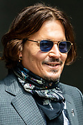 American actor Johnny Depp greets and smiles at his supporters and the members of the press as he arrives at the High Court in London on Thursday, July 23, 2020 - to attend the hearing of his legal dispute with UK tabloid newspaper The Sun over allegations he assaulted his former wife Amber Heard. (VXP Photo/ Vudi Xhymshiti)