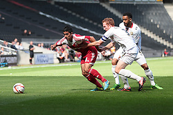 Swindon Town's Massimo Luongo is challenged by Milton Keynes Dons' Dean Lewington  - Photo mandatory by-line: Nigel Pitts-Drake/JMP - Tel: Mobile: 07966 386802 07/09/2013 - SPORT - FOOTBALL -  Stadium MK - Milton Keynes - Milton Keynes V Swindon Town - Sky Bet League one