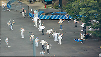 Early Morning Strech and Exercise at Niagara Falls in Shinjuku Chuo Park in Tokyo. Composite of 7 mages taken with a Nikon 1 V3 camera and 70-300 mm VR lens from my hotel room on the 20th floor in the Keio Plaza hotel (aprox. 400 meters distance).<br /> Photoshop, Statistics, Maximum.
