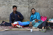 A Romanian Roma Gypsy family begging on the streets, Roberto aged 27, his wife aged 20 with their son Claudio 7 and little baby 'Capone' named after the Italian Mafia boss, 3 months old. On a good day they can get 15 euros. Republique, Paris<br /><br /> Roma Gypsies in Paris: Romanian Roma living in difficulty who have come to France looking for a better live, find themselves in a similiar predicament, facing racism from the general populus and systematic controls and evictions from their makeshift squatter camps in the suburbs and temporary places of abode inside Paris. Some recycle metal or suft through the rubbish bins looking for items to sell. Others beg or play music looking for handouts from passers by. Paris and Banlieu, Ile de France, France April 2014