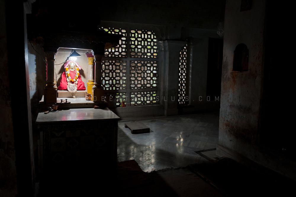 Statue of the founding guru in the temple at Mumukshu Bhawan hospice in Varanasi, India. Photo © robertvansluis.com