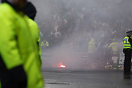 Celtic fans throw pyrotechnics onto trackside following their late goal during the William Hill Scottish Cup Final match between Heart of Midlothian and Celtic at Hampden Park, Glasgow, United Kingdom on 25 May 2019.