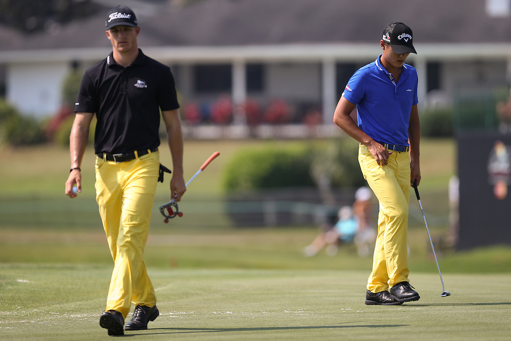 Mar 20, 2015; Orlando, FL, USA; Danny Lee (right) and Morgan Hoffmann on the 17th green during the second round of the Arnold Palmer Invitational presented by MasterCard at Bay Hill Club & Lodge . Mandatory Credit: Kevin Liles-USA TODAY Sports