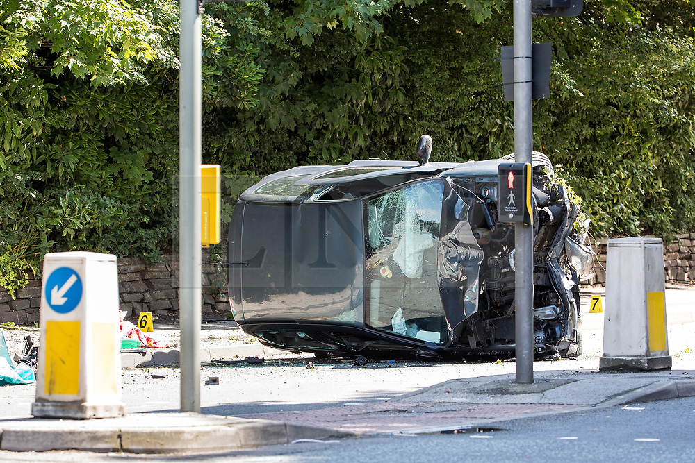 © Licensed to London News Pictures . 16/07/2017 . Manchester , UK . The Independent Police Complaints Commission have been informed following a road traffic accident near Stockport . Reports say a car struck two elderly people on the A6 Buxton Road in Heaviley at the junction with Kennerley Road and that two young males were detained by members of the public and police as they tried to make off from the scene . An undamaged silver BMW and a badly damaged dark grey Renault Clio were towed from the scene and surrounding roads have been closed to traffic as an investigation is carried out . Photo credit : Joel Goodman/LNP
