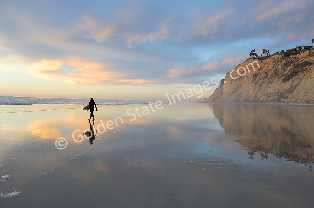 A surfer finishes the day at Blacks Beach.