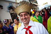 A reveler dressed in traditional Puerto Rican costume at the Festival of San Sebastian in San Juan, Puerto Rico.