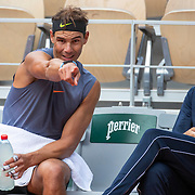PARIS, FRANCE September 26. Rafael Nadal of Spain points to the surface of the court while in discussion with coach Carlos Moya during a practice match with Jannik Sinner of Italy on Court Philippe-Chatrier in preparation for the 2020 French Open Tennis Tournament at Roland Garros on September 26th 2020 in Paris, France. (Photo by Tim Clayton/Corbis via Getty Images)
