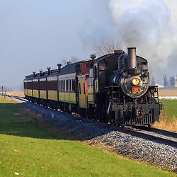 Engine 89, a steam locomotive at Strasburg Rail Road, pulls passenger cars to the station.
