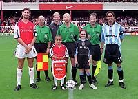 Tony Adams (Arsenal) and Mustapha Hadji (Coventry) meet the match officials and mascots before the game. Arsenal v Coventry City. FA Premiership, 16/9/00. Credit: Colorsport.
