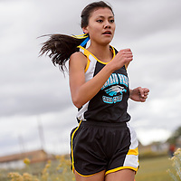 Navajo Prep Eagle Sarah Chacon finishes first in the district 1-3A meet Friday at Crownpoint High School.