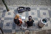 Street musicians playing at Kampa Island underneath Charles Bridge.