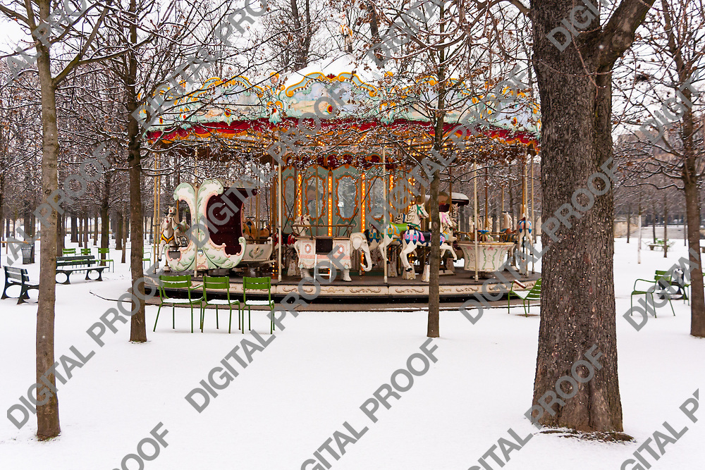 Carousel surrounded by snow in the Jardin de Tuileries in Paris France