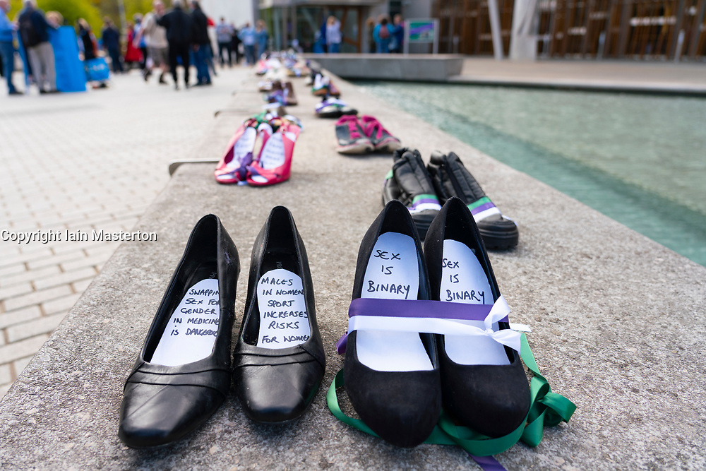 Edinburgh, Scottish Borders, Scotland, UK. 2  May 2021. ALBA party women candidates  gathered outside the Scottish Parliament to highlight the ALBA Women and Equalities policy. Under the hashtag Women Voting With Our Feet, hundreds of pairs of women's shoes were laid out in front of Scottish Parliament with messages of support for sex-based rights of women. ALBA list candidate  Tasmina Ahmed-Sheikh said that ALBA are making it loud and clear that they will always stand up for women's sex based rights and that women and girls will always be respected by ALBA.<br /> Iain Masterton/Alamy Live News