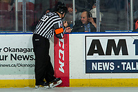 KELOWNA, BC - JANUARY 31: Referee Chris Crich speaks to time keepper Lorne Craig during second period at the Kelowna Rockets against the Spokane Chiefs at Prospera Place on January 31, 2020 in Kelowna, Canada. (Photo by Marissa Baecker/Shoot the Breeze)