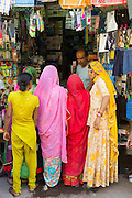 Indian women shopping, street scene at Tambaku Bazar in Jodhpur Old Town, Rajasthan, Northern India