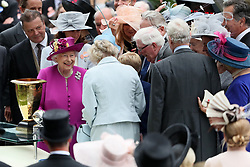 Queen Elizabeth II presents the trophy for the Diamond Jubilee Stakes during day five of Royal Ascot at Ascot Racecourse.