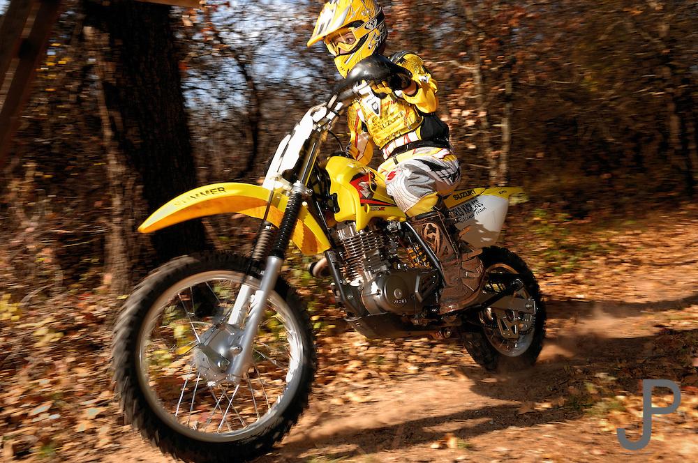 Summer Hopkins on her Suzuki dirt bike