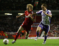 Photo: Paul Thomas.<br /> Liverpool v Toulouse. UEFA Champions League Qualifying. 28/08/2007.<br /> <br /> Dirk Kuyt of Liverpool in action against Mauro Cetto (R).