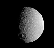 The Cassini spacecraft takes a close look at a row of craters on Saturn's moon Tethys during the spacecraft's April 14, 2012, flyby of the moon.