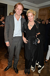 PRINCE & PRINCESS VALERIO MASSIMO DI ROCCASECCA at a party to celebrate the publication of 'Let's Eat meat' by Tom Parker Bowles held at Fortnum & Mason, Piccadilly, London on 21st October 2014.