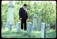 Man in costume at Oak Hill Cemetery; many SPOON RIVER ANTHOLOGY characters lie there; Lewistown. Illinois