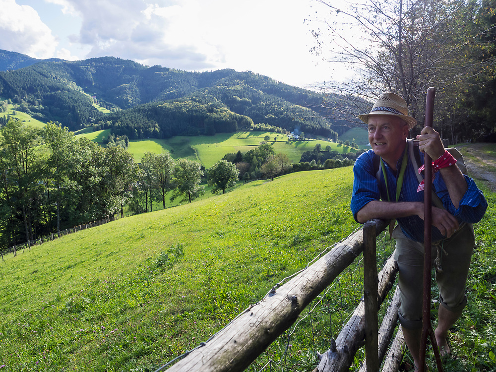 Senior man leaning on railing in Middle Black Forest Baden-Wuerttemberg, Germany