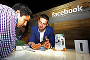 Facebook's director of small business Jonathan Czaja offers tips and advice to an attendee at Facebook's Boost Your Business Nashville event held at Marathon Music Works on Thursday, Aug. 27, 2015, in Nashville, Tenn. (Photo by Wade Payne/Invision for Facebook/AP Images)