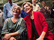 "20 OCTOBER 2019 - INDIANOLA, IOWA: US Senator ELIZABETH WARREN (D-MA), right, poses for a ""selfie"" with a woman after her campaign speech at Simpson College in Indianola, IA, Sunday. Sen. Warren is campaigning to be the Democratic nominee for the US presidency in Iowa this week. Iowa traditionally hosts the the first selection event of the presidential election cycle. The Iowa Caucuses will be on Feb. 3, 2020.                 PHOTO BY JACK KURTZ"