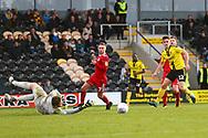 Burton Albion midfielder Ben Fox (12) shoots during the EFL Sky Bet League 1 match between Burton Albion and Accrington Stanley at the Pirelli Stadium, Burton upon Trent, England on 23 March 2019.