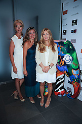 Left to right, TAMARA BECKWITH, TANAZ DIZADJI and AMANDA KYME at a private view of Sacha Jafri's paintings entitled 'London to India' held in aid of The Elephant Family charity at 23 Macklin Street, Covent Garden, London on 3rd June 2010.