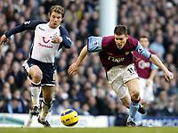 Photo: Chris Ratcliffe.<br />Tottenham Hotspur v Aston Villa. The Barclays Premiership. 21/01/2006.<br />James Milner (R) of Villa and Teemu Tainio tussles for the ball.