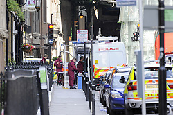 June 4, 2017 - London, UK - London, UK. Forensic staff are seen close to Borough Market.  Police cordons continue to be in place around London Bridge after the previous night's terrorist attack where a reported three attackers were shot by the police and seven members of the public died after being attacked with knives. (Credit Image: © Stephen Chung/London News Pictures via ZUMA Wire)