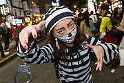 A young Japanese woman dressed as a prisoner during the Halloween celebrations in Shibuya, Tokyo, Japan. Saturday October 29th 2016 Halloween celebration in Japan have grown massively in the last few years. To ensure the safety of the crowds in Shibuya this year, the police closed several roads leading to the famous Hachiko Square, allowing costumed revellers to spread over a larger area.