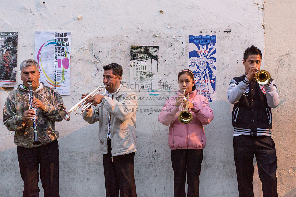 A mariachi band plays on the street during the Day of the Dead Festival known in Spanish as Día de Muertos on in Oaxaca, Mexico.