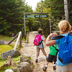 A woman and her kids at the entrance to Lost River Gorge in New Hampshire's White Mountains. North Woodstock.