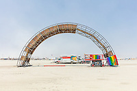 Rainbow Bridge build by: Josh Zubkoff from: San Francisco, CA year: 2018<br /> <br /> Debuting at Burning Man 2018, The Rainbow Bridge is a 100′ long walkable rainbow bridge that will rise from the morning mist and dazzle with LEDs at night. A great place for a contemplative walk, romantic stroll, to meet friends, or just to sit and embrace the moment. Rainbows represent love, magic, and wonder – some of our favorite aspects of Burning Man. URL: http://giantrainbow.com Contact: jazlink@gmail.com