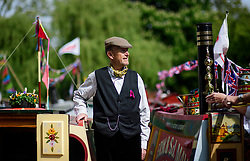 © Licensed to London News Pictures.30/04/2017.London, UK. Robin Ormerod stands with his narrowboat as the Canalway Cavalcade festival takes place in Little Venice, London on Saturday, 30 April 2017. Inland Waterways Association's annual gathering of canal boats brings around 130 decorated boats together in Little Venice's canals on May bank holiday weekend. Photo credit: Ben Cawthra/LNP