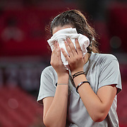 TOKYO, JAPAN - JULY 24: Twelve year old Hend Zaza of Syria, the youngest competitor in the Olympic Games in tears during her loss against Jia Liu of Austria in the Women's Singles  Preliminary Round in the Tokyo Metropolitan Gymnasium at the Tokyo 2020 Summer Olympic Games  on July 24, 2021 in Tokyo, Japan. (Photo by Tim Clayton/Corbis via Getty Images)