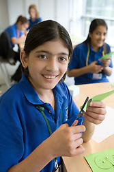 Secondary School Asian girls in Technology class,