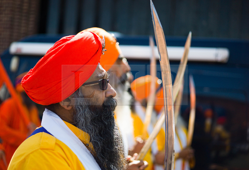 © Licensed to London News Pictures.12/07/15<br /> Middlesbrough, UK. <br /> <br /> Hundreds of members of the Sikh community celebrate the Nagar Kirtan Sikh Festival in Middlesbrough, Cleveland with a parade through the town. The festival celebrates love, happiness, and peace, from people from all backgrounds and religions.<br /> <br /> Nagar Kirtan is a Punjabi term signifying the neighbourhood singing of Shabads or divine hymns.<br /> <br /> Photo credit : Ian Forsyth/LNP