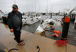 August 26, 2017 - Rockport, Texas, U.S. - ROBERT ZBRANEK stands near his boat, Sweet Mother of Pearl, which sank in the violence of Hurricane Harvey hitting the gulf coast. Zbranek initially rode out the category four storm in the boat but as the storm grew in intensity, the winds caused the boat to wreck into the pier and ruptured the side of the boat. He got out and sought shelter in his car until daybreak. Zbranek also owns two other boats but was using the one that was damaged as his personal craft. (Credit Image: © San Antonio Express-News via ZUMA Wire)