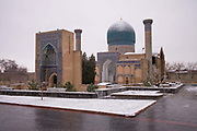 Fresh snow on the The Gur-i Amir Mausoleum on 23rd February 2014 in Samarkand, Uzbekistan. The Gūr-i Amīr or Guri Amir, is the mausoleum of the Asian conqueror Timur, also known as Tamerlane. Samarkand, meaning Stone Fort is one of the oldest populated cities in Central Asia, prospering from its location on the Silk Road between China and the Mediterranean.