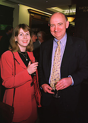 MR TIM WATERSTONE, founder, chairman and chief executive of Waterstone's Booksellers Ltd. and his wife writer ROSIE ALISON, at a party in London on 29th April 1998.MHH 12