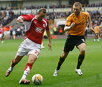 Photo: Steve Bond/Sportsbeat Images.<br /> Wolverhampton Wanderers v Bristol City. Coca Cola Championship. 03/11/2007. Lee Trundle (L) controls the ball as Neill Collins (R) closes in