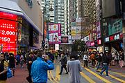 Pedestrians shopping on Paterson Street, Hong Kong.