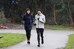 © Licensed to London News Pictures. 07/02/2021. London, UK. Joggers brave light snowfall, freezings temperatures and strong winds in a north London park as Storm Darcy arrives in the capital. The Met Office has issued yellow warnings for snow as cold air from Russia and Eastern Europe makes its way across the UK. Photo credit: Dinendra Haria/LNP
