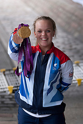 © Licensed to London News Pictures. 10/09/2012. LONDON, UK. Paralympic medal winning swimmer Ellie Simmonds holds up her medals at a reception for British Olympic and Paralymic athletes held at the Queen Elizabeth II Conference Centre in London today (10/09/12). Photo credit: Matt Cetti-Roberts/LNP