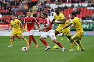 Charlton Athletic midfielder Ricky Holmes (11) is pressured by AFC Wimbledon striker Andy Barcham (17) and AFC Wimbledon striker Tom Elliott (9) during the EFL Sky Bet League 1 match between Charlton Athletic and AFC Wimbledon at The Valley, London, England on 17 September 2016. Photo by Stuart Butcher.
