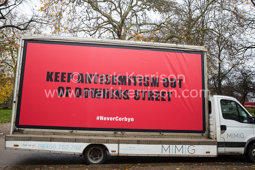London, UK. 26 November, 2019. A hoarding bearing the words 'Keep Antisemitism Out of Downing Street' parked outside the Bernie Grant Arts Centre in Tottenham before the arrival of Labour Party leader Jeremy Corbyn to launch Labour's new Race and Faith Manifesto.